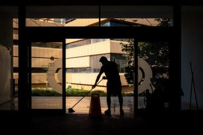 Man cleaning the office